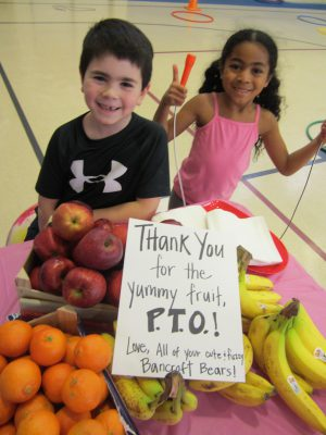 Smiling children with healthy snack