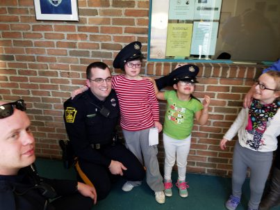 Children with police officer