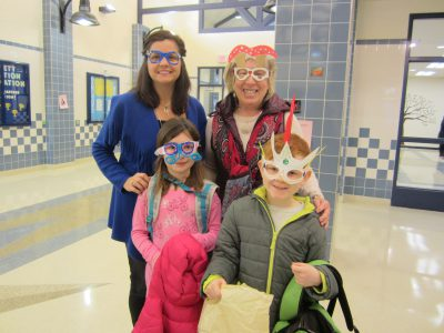 Principal Mrs. McComsey and Art Teacher Mrs. Finn pose with students wearing their creative sunglasses!