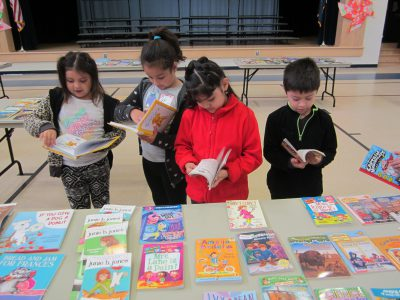 Children selecting a book
