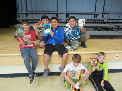 Children showing their new books