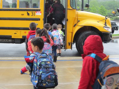 Students going onto school bus