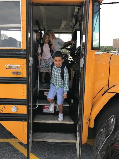 Students walking off a school bus