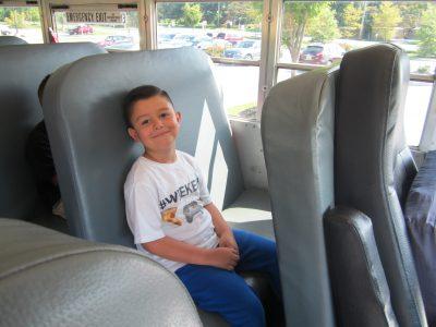 Student sitting on school bus