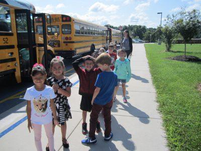 Students walking off school bus