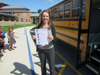Teacher holding school-wide positive behavior matrix