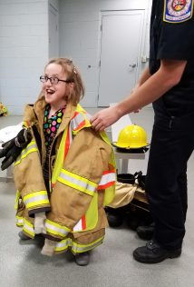 Student modeling firefighter's clothing