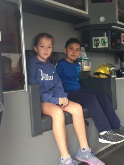 Students inside a fire truck