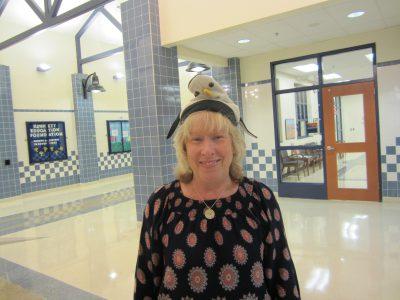 Teacher wearing hat