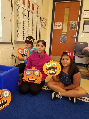 Children holding pumpkins