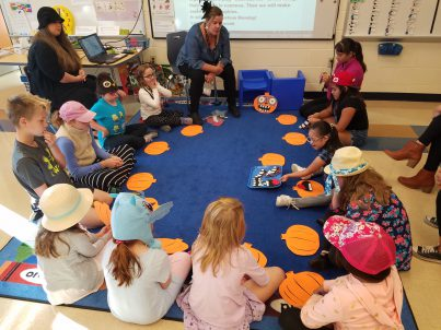 Children in circle for Morning Meeting