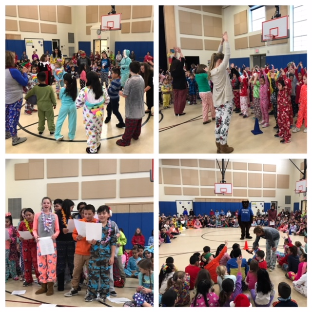 Students and teachers participating in school wide morning meeting