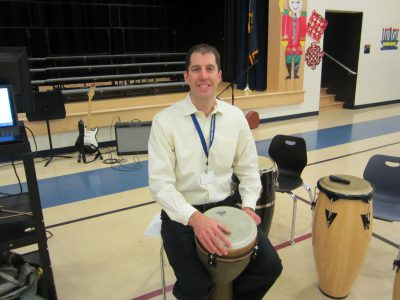 Mr. Green, Bancroft music teacher, playing the drum