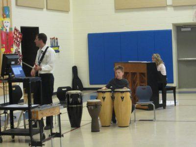 Student playing bongo drums