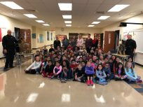 Third grade students with teachers, principal, police officers and K-9 dogs
