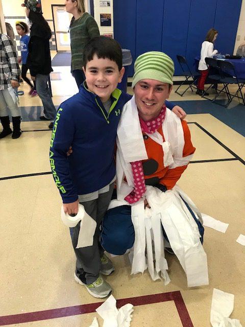 Child with teacher snowman