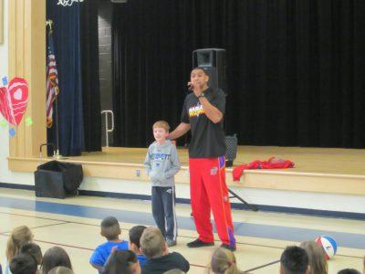 Harlem Wizards' basketball player David Paul and Bancroft student