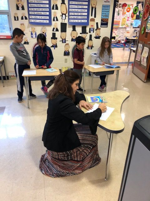 Principal reading student published book