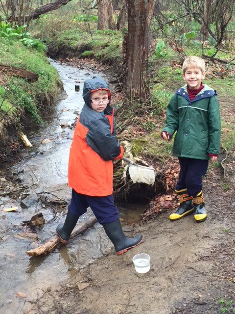 students near stream