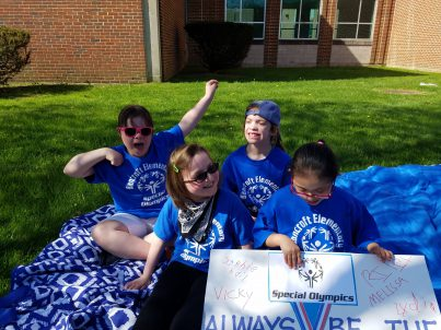 Students celebrating At Special Olympics