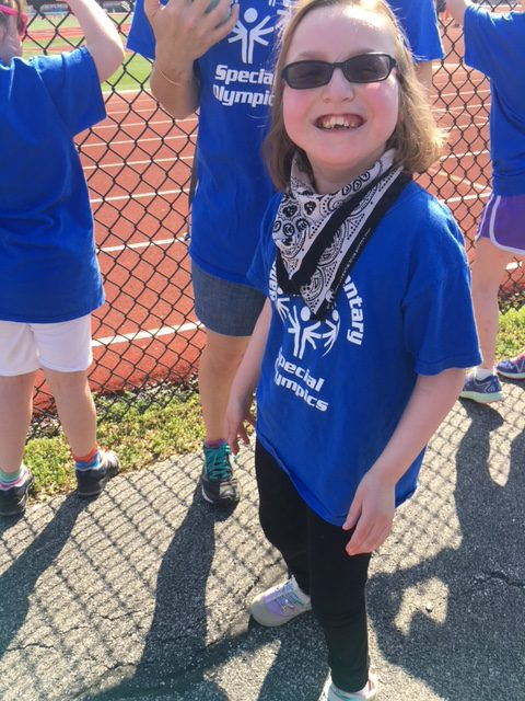 Student celebrating at Special Olympics