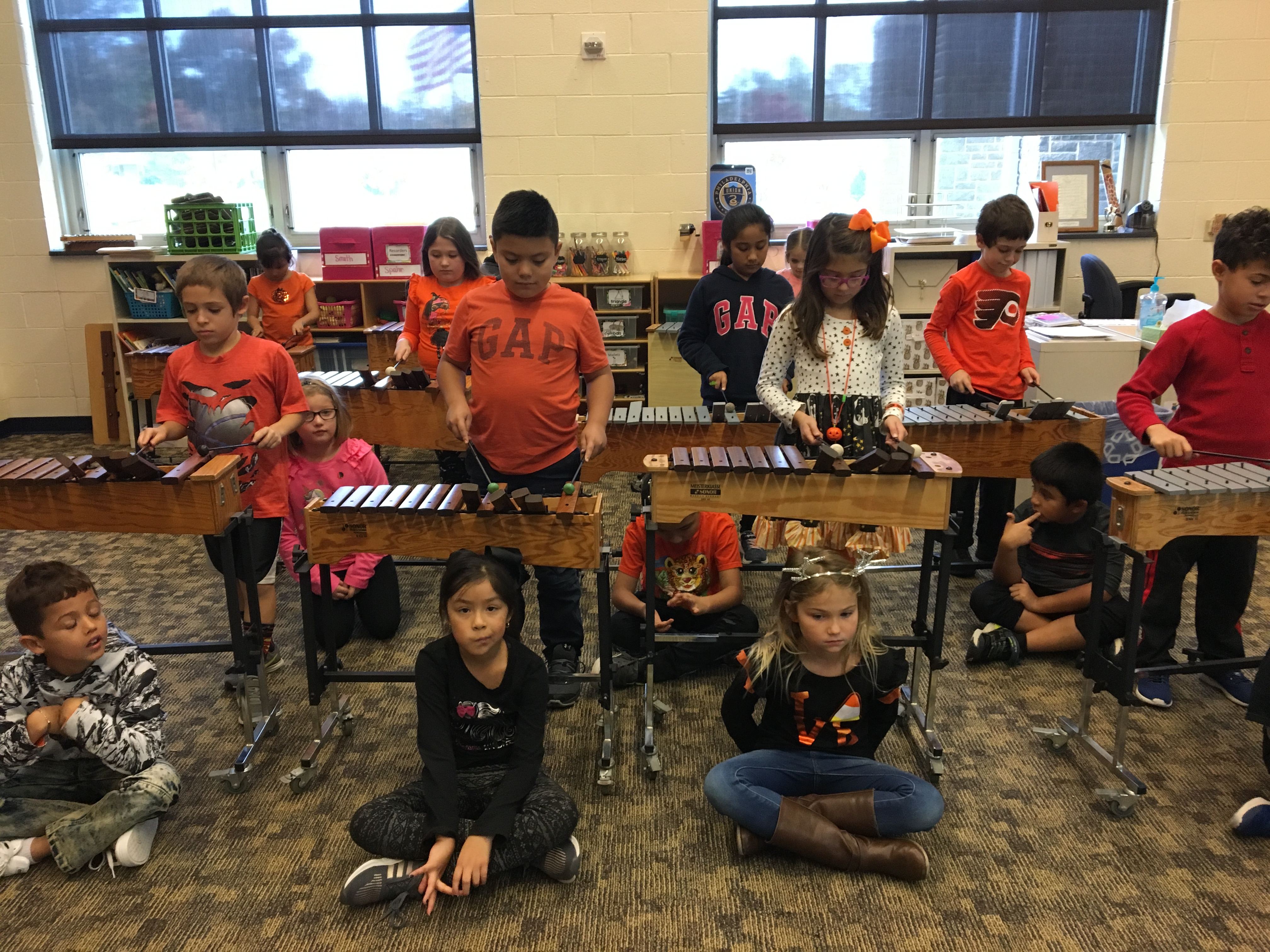 students playing zylophones