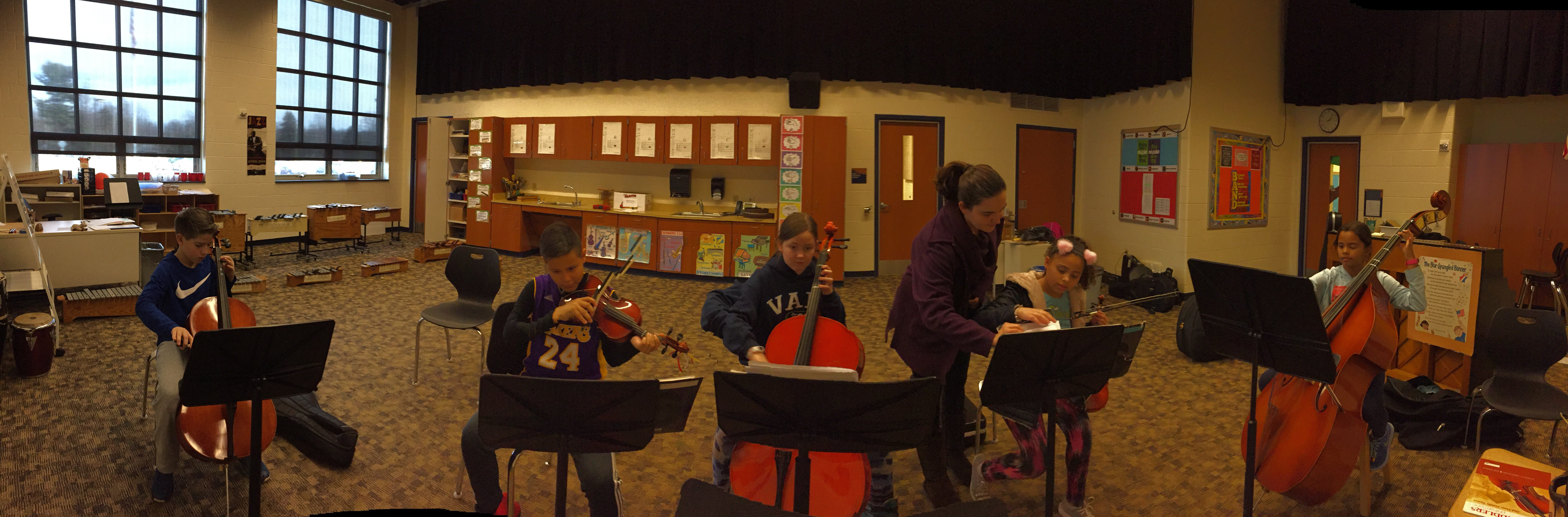 orchestra students practicing with instruments