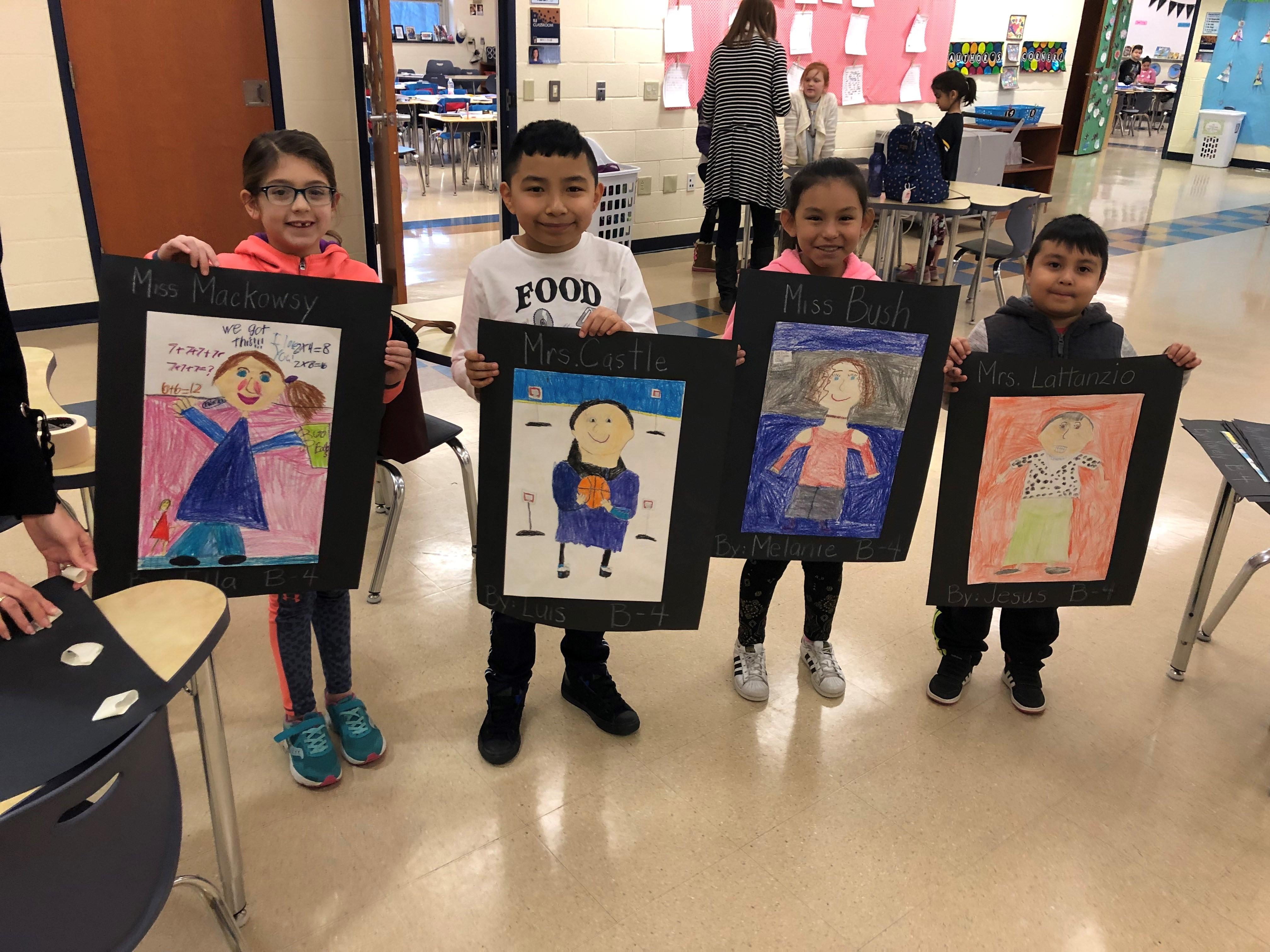 students holding portrait