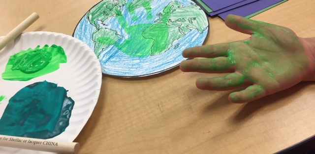 hand painted green on paper plate