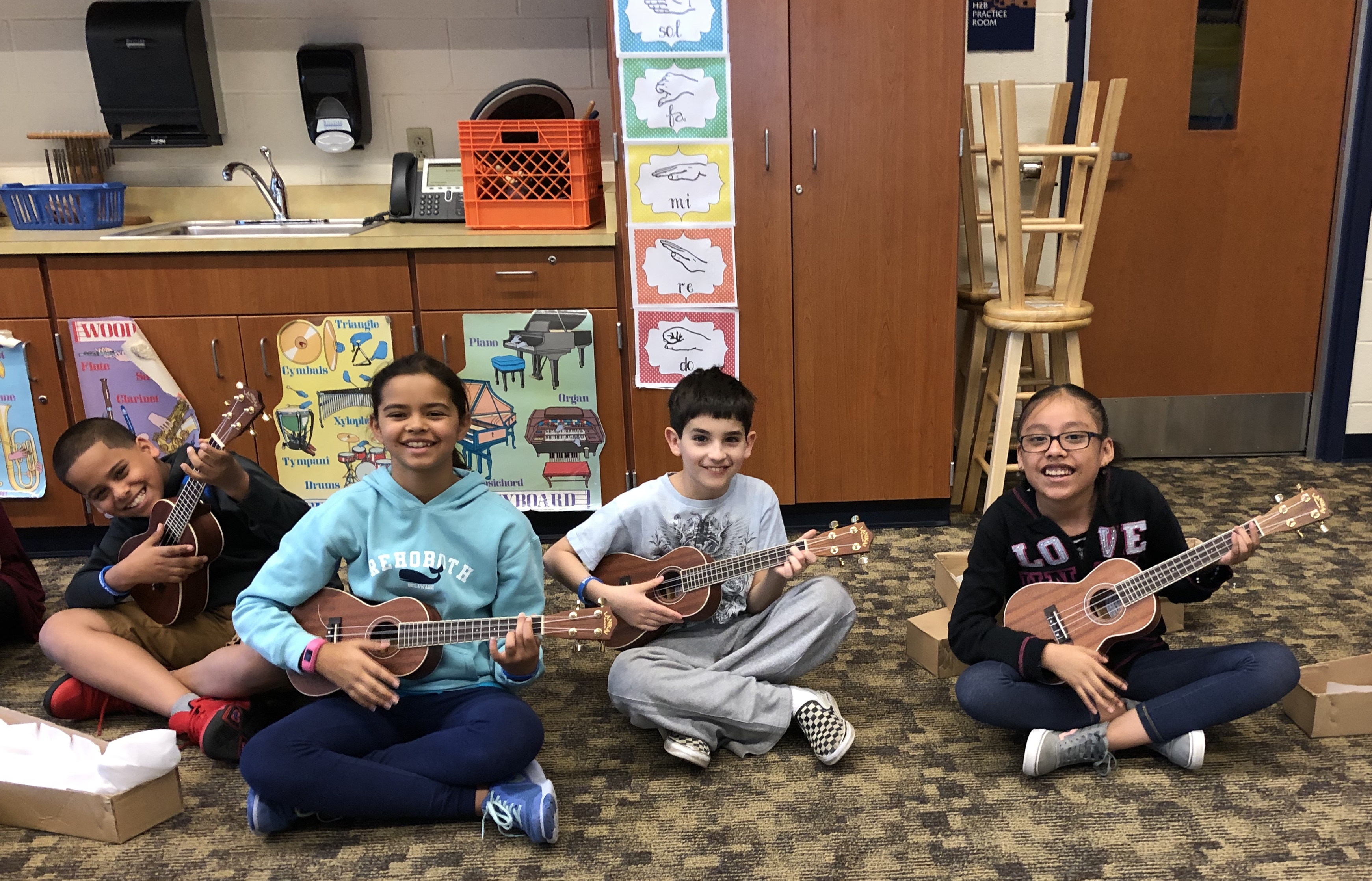 students playing the ukulele