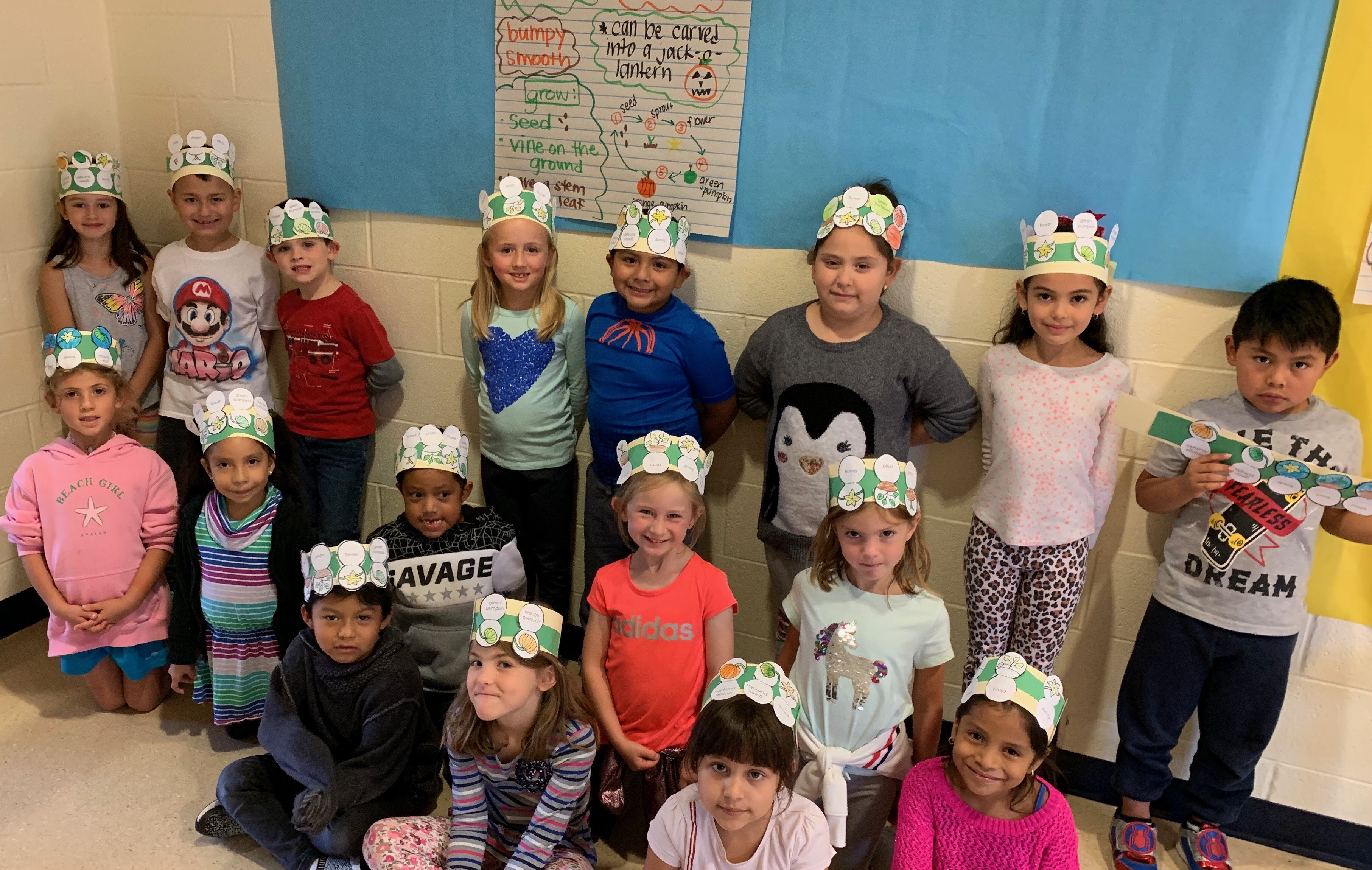 students smiling with crowns