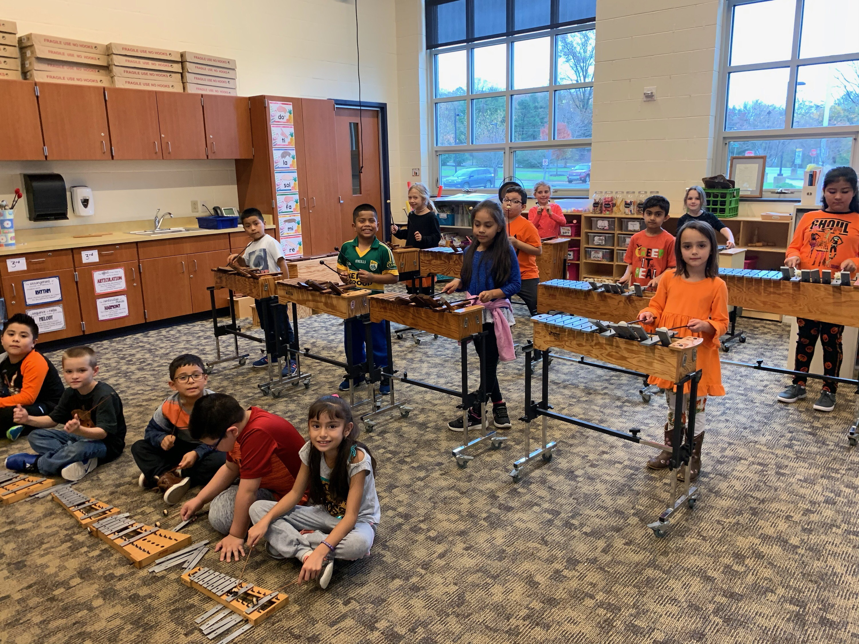 students playing the xylophone